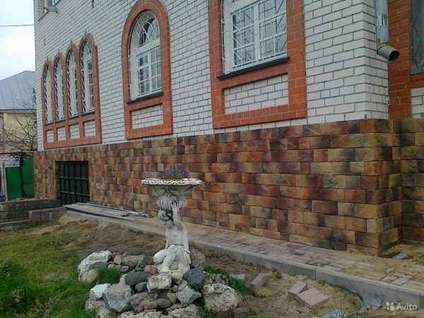 Отделка цоколя камнем, утепление фасада