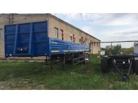 Полуприцеп НЕФАЗ 9334-24-10 с кониками, тягач КАМАЗ-43118